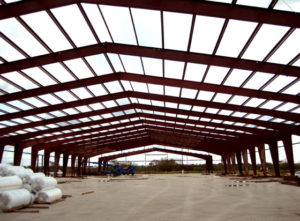Photo of a industrial steel warehouse under construction.