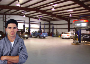 Photo of mechanic inside a RHINO building used as auto repair shop.