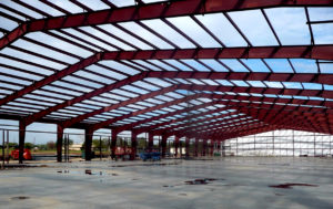 Photo of the framing of a RHINO steel industrial warehouse under construction.