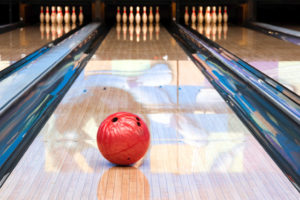 Photo of a ball rolling down a bowling alley.