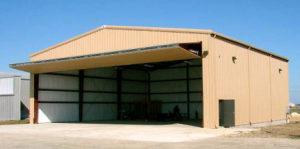 Photo of a bi-fold hangar door on a RHINO steel hangar.
