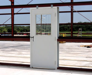 Photo of an entry door installed in a RHINO steel frame.